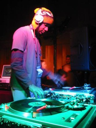 Disc jockey - DJ Spooky at the Sundance Film Festival in 2003, using two Technics SL-1200 turntables and a DJ mixer