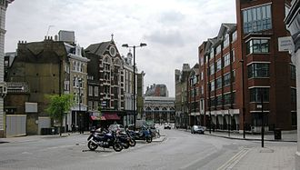 Great North Road (Great Britain) - Southern end of St John Street, with Smithfield Market visible in the distance. The island in the middle of the road marks the former site of Hicks Hall.