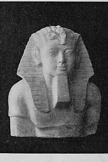 Upper half of statue of Hakor. In Cairo Museum