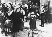 Women and children removed from a bunker by SS men during the Warsaw Ghetto uprising for deportation to a death camp Stroop Report - Warsaw Ghetto Uprising BW.jpg