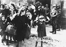 Women and children forced out of a bunker by armed SS men during the suppression of the Warsaw Ghetto uprising Stroop Report - Warsaw Ghetto Uprising BW.jpg