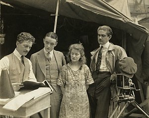 George Hill (director) - From left to right are  director John W. Noble, actors Robert Harron and Mae Marsh, and cameraman George W. Hill in a production still for Sunshine Alley (1917)