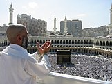 Muslim pilgrim praying in the direction of the Kaaba