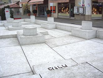 Dani Karavan - A memorial created by Dani Karavan in 2005, depicting the foundation of the Regensburg Synagogue that was destroyed during a pogrom in 1519. The inscription 'מזרח' in Hebrew is 'east' in English.
