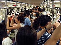 Inside a Taipei MRT train during rush hour.