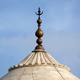 Finial element marking the top or end of some object; decorative feature