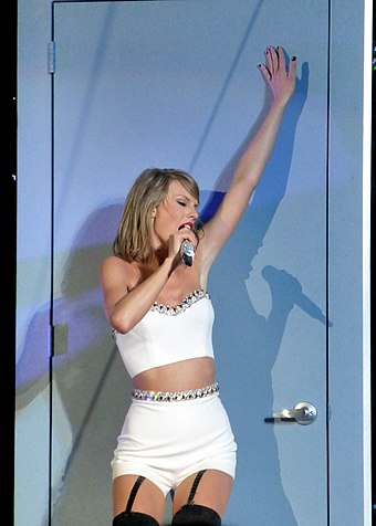 Swift performing during the 1989 World Tour, the highest-grossing tour of 2015 Taylor Swift 039 (18117627828).jpg