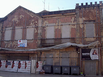 Rua Santos Minho - The decaying facade of Garrett Theatre and protest poster in 2009.