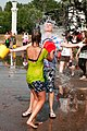 Teens wetlooking during a public water fight in Moscow.jpg