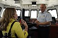 Thad Allen briefs a reporter on a mockup of the bridge of a Fast Response Cutter.jpg