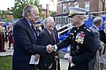 "The 35th Commandant of the Marine Corps, Gen. James F. Amos, right, speaks with Medal of Honor recipient and retired Marine Harvey ""Barney"" Barnum, center, and another an attendee following the retirement 130509-M-LU710-422.jpg"