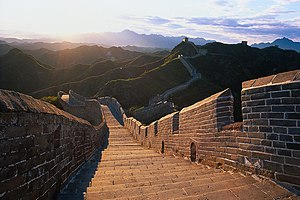 One of the greatest wonders of the world, the Great Wall winds up and down across deserts, grasslands, mountains and plateaus stretching approximately 6,700 kilometers (4,163 miles ) from east to west of China.