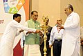 "The Union Minister for Agriculture and Farmers Welfare, Shri Radha Mohan Singh lighting the lamp to inaugurate the ""National Conference on Agriculture for Rabi Campaign, 2016"", in New Delhi.jpg"