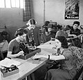 The sewing room in the war workers hostel at Royal Ordnance Factory, Bridgend, during January 1942. D6343.jpg