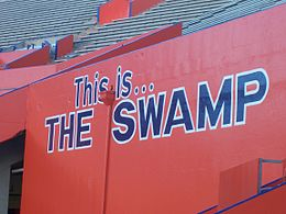 "Orange bleacher wall reading, ""This is ... THE SWAMP"""
