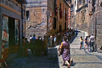 Spanish transition to democracy - People waiting to vote in the 1977 general election in Toledo. The 1977 general election was the first free election since February 1936.