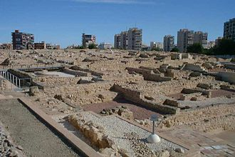 Lucentum - The archaeological site is surrounded by the buildings of modern Alicante.