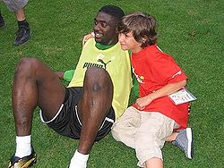 Kolo Touré with a young fan.