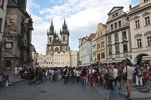 Tourists at the Astronomical Clock in Prague D...