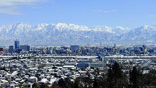 呉羽丘陵から望む立山連峰と富山市街