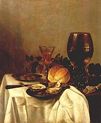 Still life with plates of oysters and olives, wineglasses and a bread roll