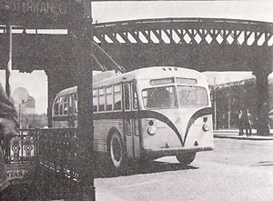 Palermo (Buenos Aires Underground) - Palermo station ground level exit with trolleybus, and railway bridge in the background (1950).