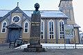 Tromsø Cathedral (domkirke) Norway Adolf Thomsen monument by Trygve Thorsen 1943 unveiled 1946 (Å eg veit meg eit land), Kirkeparken info board, Wooden Gothic Revival style long church 1861 2019-04-04 DSC02177.jpg