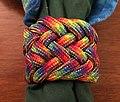 Turks head PARACORD slide. RAINBOW COLOR Variant of a gaucho knot 3-2-2-3.jpg