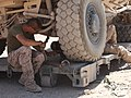 Two U.S. Marines, with 2nd Maintenance Battalion, 2nd Marine Logistics Group (Forward), hook chains onto a lift so they can tow a damaged vehicle at Forward Operating Base Edinburgh, Afghanistan, June 20, 2011 110620-M-UV027-052.jpg