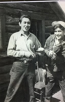 Two men with fiddle and bow - Kaska Dena - Lower Post BC 1945