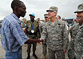 U.S. Air Force Gen. Douglas Fraser, commander of U.S. Southern Command, is greeted by a camp leader at Ancien Aeroport Militaire in Port-au-Prince, Haiti, March 6, 2010 100306-N-HX866-012.jpg
