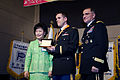 U.S. Army Capt. Vladislav Silayev, center, the commander of Headquarters and Headquarters Company, is recognized for his community outreach and selfless service during the People to People International (PTPI) 131220-A-LI672-858.jpg