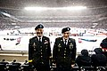 U.S. Army Maj. Gen. David J. Conboy, left, the commander of the 416th Theater Engineer Command, stands with Sgt. John Pudowski before a National Hockey League (NHL) game at Soldier Field in Chicago March 1 140301-A-TI382-271.jpg