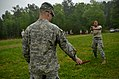 U.S. Army Pvt. Deidra Reinatdixon, right, with Headquarters and Headquarters Company, 105th Military Police Battalion, North Carolina Army National Guard, makes her way through a defense course during oleoresin 130501-Z-AY498-017.jpg