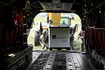 U.S. Army Sgts. Michael Backowski and Elisabeth Mashaw, both crew chiefs assigned to Bravo Company, 5th Battalion, 159th Aviation Regiment, load a pallet of medical supplies onto a CH-47 Chinook helicopter 130813-F-QA406-048.jpg
