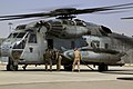 U.S. Marine Corps Lance Cpl. Gage Cusker, right, a nozzle operator with Marine Wing Support Squadron (MWSS) 274, lifts a hose to fuel a CH-53E Super Stallion helicopter at a forward arming and refueling point 140903-M-EN264-034.jpg
