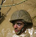 U.S. Marine Corps Pfc. Ross Simpson, with 7th Communications Battalion, advances through an obstacle course at the Jungle Warfare Training Center at Camp Gonsalves, Okinawa, Japan, on Aug. 21, 2009 090821-M-WA483-235.jpg