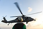 U.S. Navy Chief Aviation Structural Mechanic Brian Brooks, assigned to Helicopter Sea Combat Squadron (HSC) 7, watches an MH-60S Seahawk helicopter launch from the flight deck of the aircraft carrier USS Harry 140307-N-ZG705-035.jpg