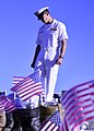 U.S. Navy Chief Naval Aircrewman (Helicopter) Matthew Meadows looks at a display representing fallen Service members before a 9-11 commemoration ceremony in Pearl Harbor, Hawaii, Sept 140911-N-DT805-103.jpg