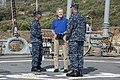 U.S. Navy Cmdr. Dave Stoner, left, the commanding officer of the guided missile destroyer USS Ramage (DDG 61), and Command Master Chief Joseph O'Brien, right, the Ramage's command master chief, welcome 131115-N-VC236-017.jpg