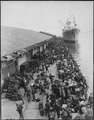 U.S. troops are pictured on pier after debarking from ship, somewhere in Korea. - NARA - 531367.tif