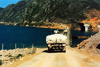 United Nations Protection Force - Dutch UN Transportbatallion crossing a Pontoon bridge over the river Neretva from the M17 towards the west with, Bosnia and Herzegovina. Early 1995