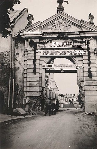 "Stepan Bandera - Geetings archway ""Glory Hitler! Glory to Bandera!""(Ukrainian). Western Ukraine, July -August 1941."