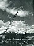 USS Lunga Point (CVE-94) loading a P-47D Thunderbolt at Finschhafen on 15 July 1944.jpg