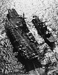 USS Niagara Falls (AFS-3) replenishes USS Coral Sea (CVA-43) in February 1970.jpg