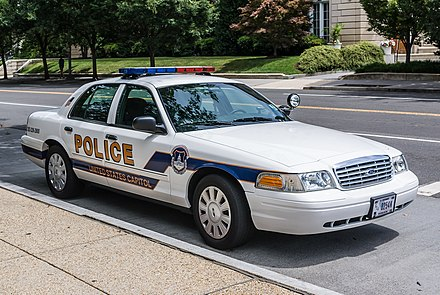 A Ford Crown Victoria, one of the most recognizable models of American police car. This unit belongs to US Capitol Police. US Capitol Police Cruiser Ford Crown Vic fr.jpg