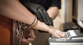 US Marshals fingerprinting prisoner.png