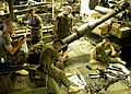 US Navy 040611-N-2972R-008 Marines perform maintenance on their weapons in the amphibious assault ship's upper vehicle storage area. USS Kearsarge (LHD 3).jpg