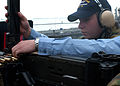 US Navy 041013-N-6125G-020 Gunner's Mate Seaman Lance Zielinski loads a .50 caliber machine gun.jpg