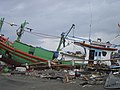 US Navy 050101-O-XXXXB-067 Boats washed ashore near local businesses in down town Aceh, Sumatra following a massive Tsunami that struck the area on the 26th of December 2004.jpg
